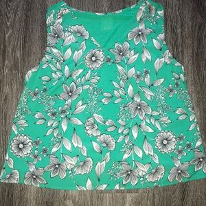 Green and white floral blouse